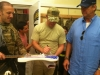 Jason Hewlitt blog 7-23-2014 10 .jpg signing guitar David in background