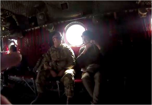 Afghanistan Chinook  David puts on helmet  plane  screencap credi vid Jason Hewlitt