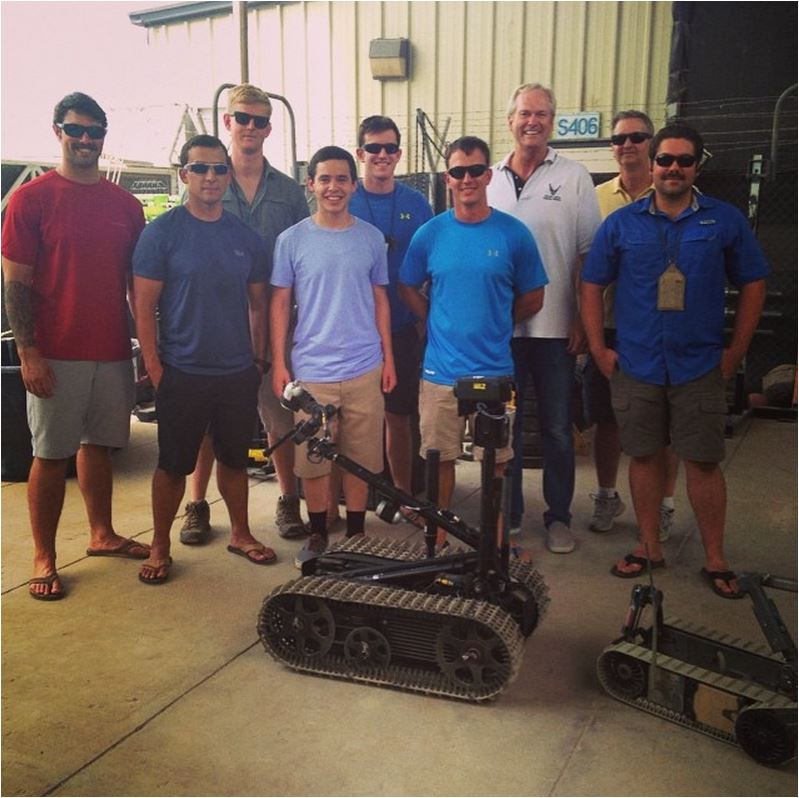 Djibouti EOD specialists and bomb diffusing robot credit David Archuleta