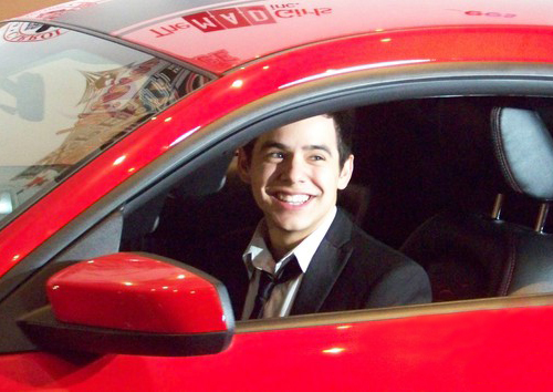 david in a red car automobile vehicle