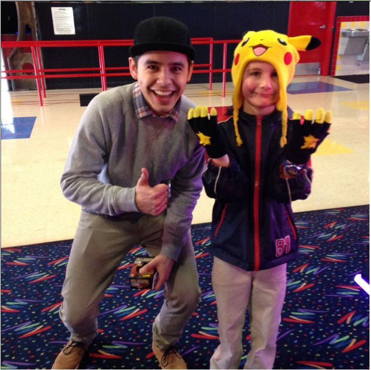 IG pic David with kid in Pikachu hat