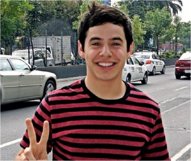 David Archuleta  (crop) posing by Nandito Ako billboard- credit Kari Sellards