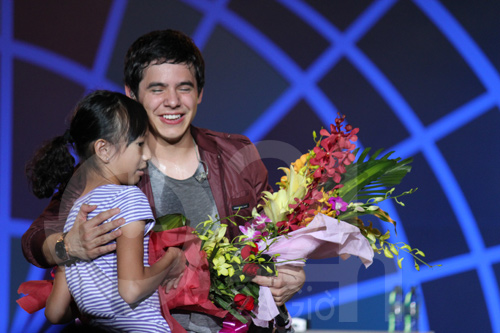 Flowers on stage and a hug