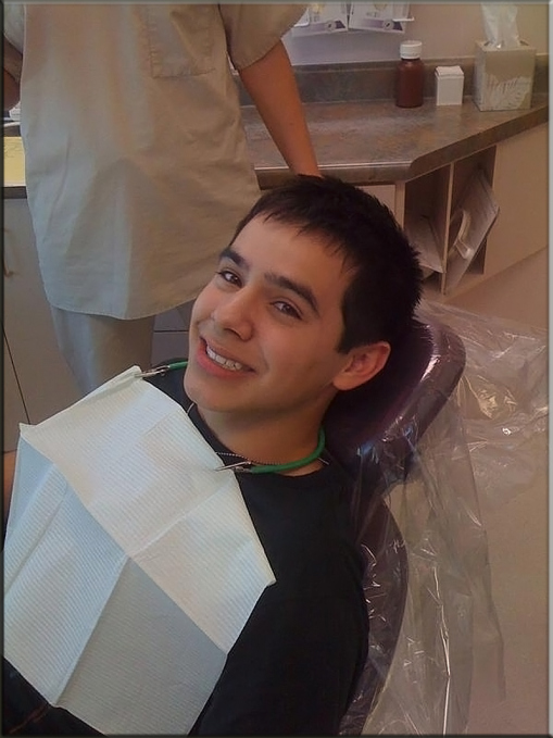 David Archuleta is lying back smiling at At the dentist~ Oct. 17, 2008 ~ credit fanblast