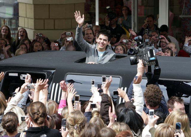 - David waves to his adoring fans - credit Deseret News