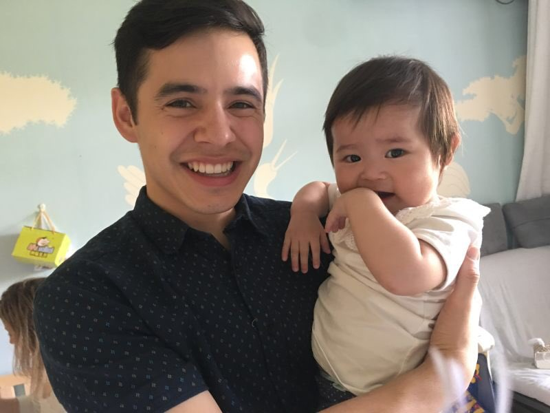 A picture of David Archuleta and little Snow at Holt International orphanage in China