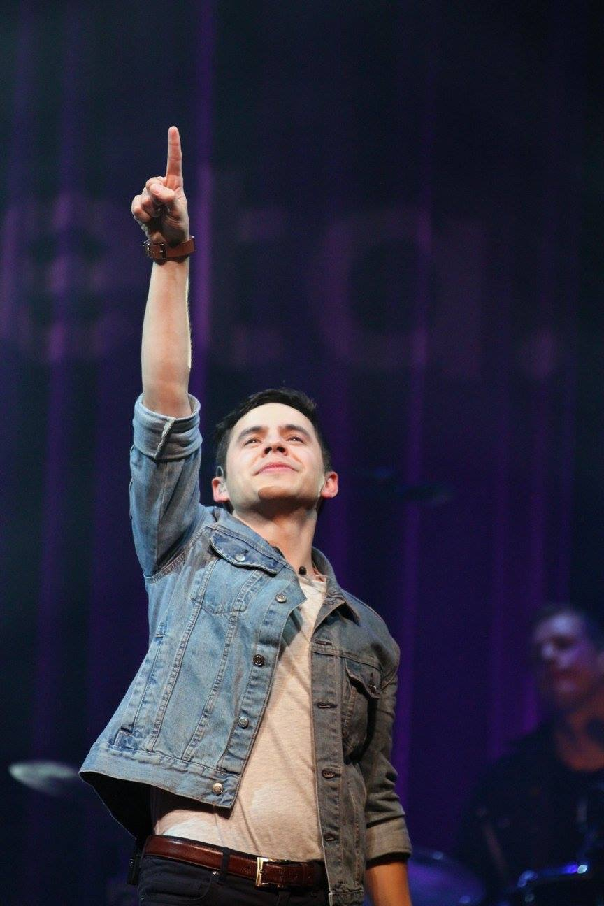 David Archuleta points to the heavens at a concert in Franklin Tennessee at the Franklin Theater