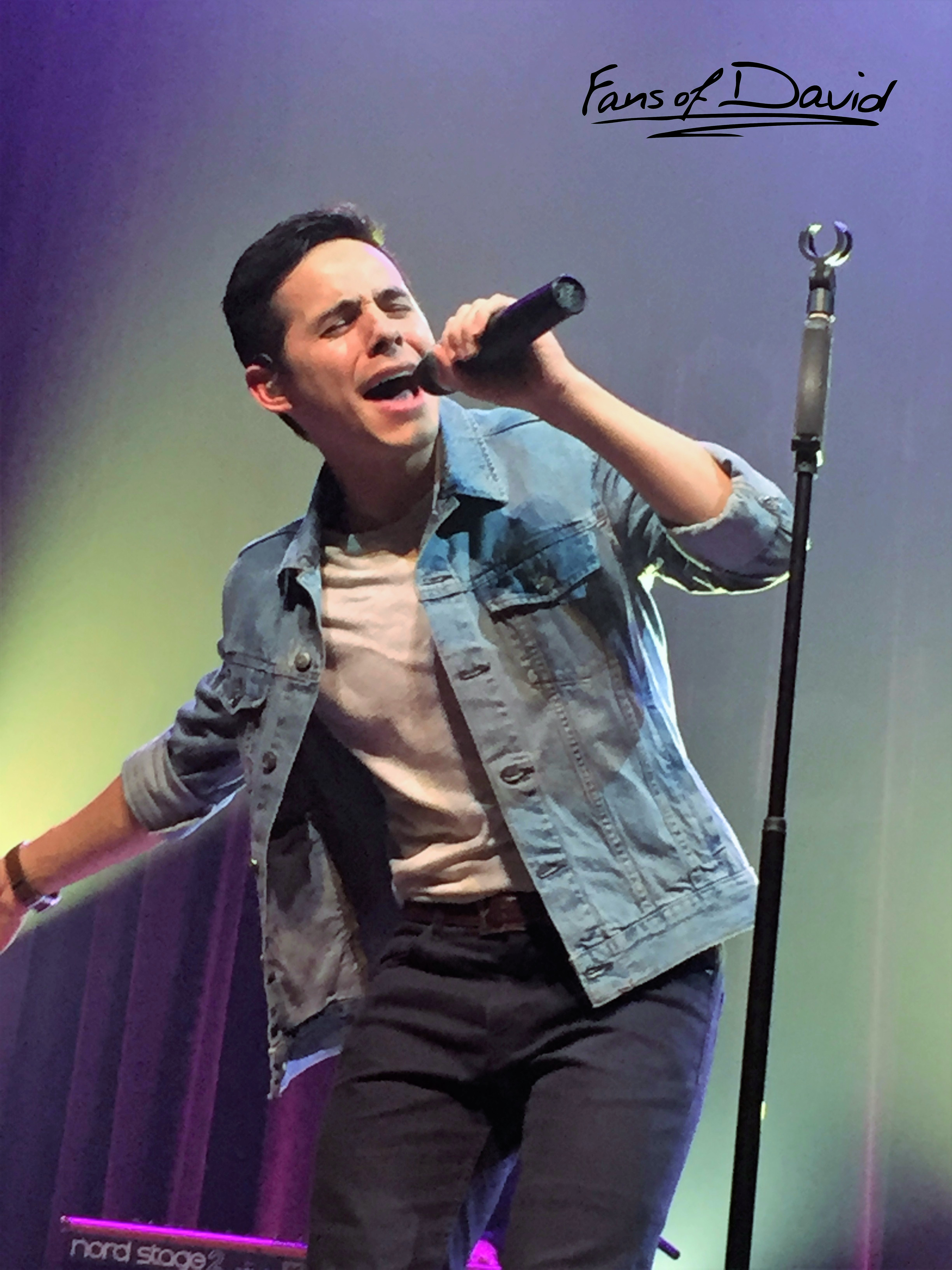 David Archuleta holding mike on stage in Franklin Tennessee